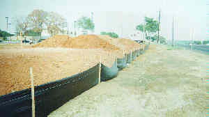 Woven Geotextil silt fence attached to wood stakes